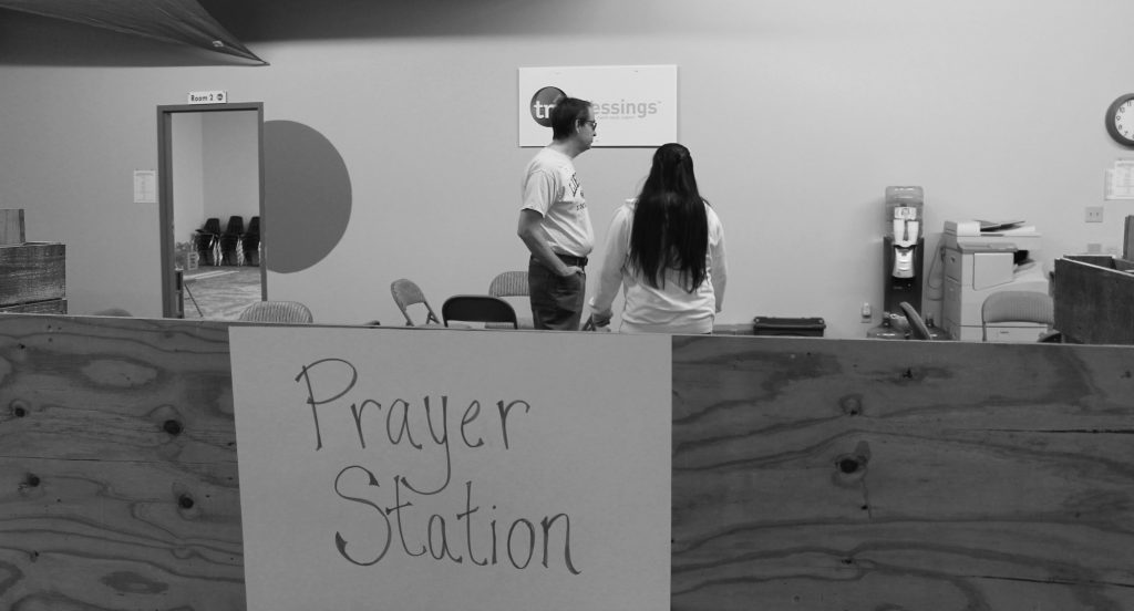 The prayer station at Delaware City Vineyard is an optional component of their FEED event. Members of the church offer prayers and support to anyone who wishes to receive it.