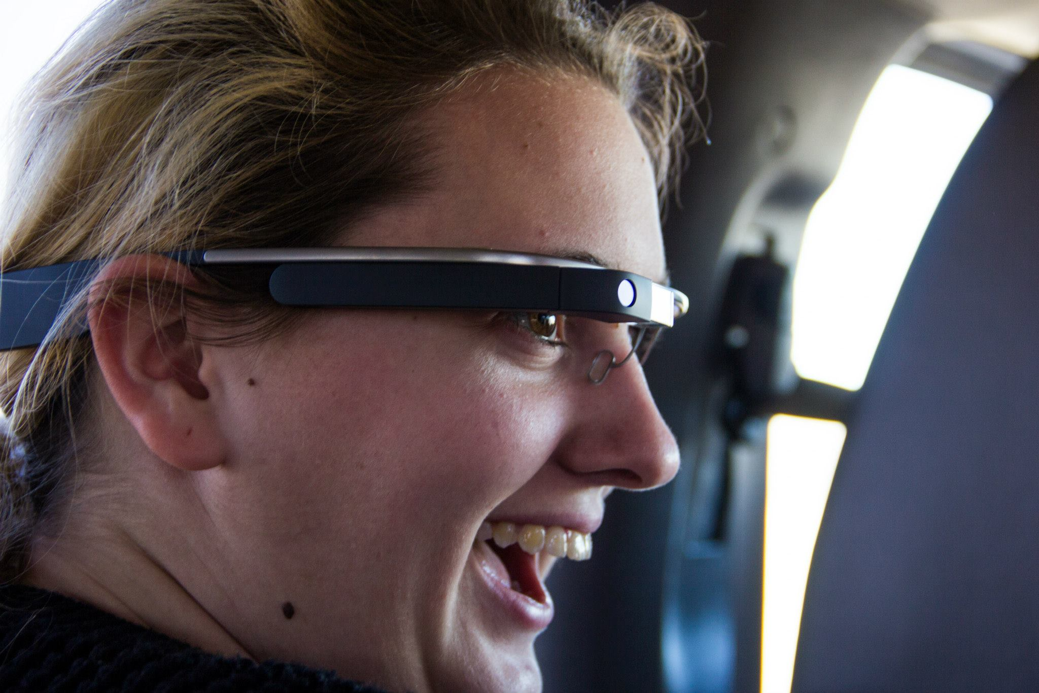 An OWU student on a Spring Break Mission Trip delighted with Google Glass.